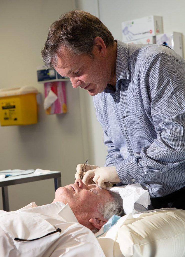 Bunbury and Busselton Eye Doctors Neil Sinclair conducting surgery